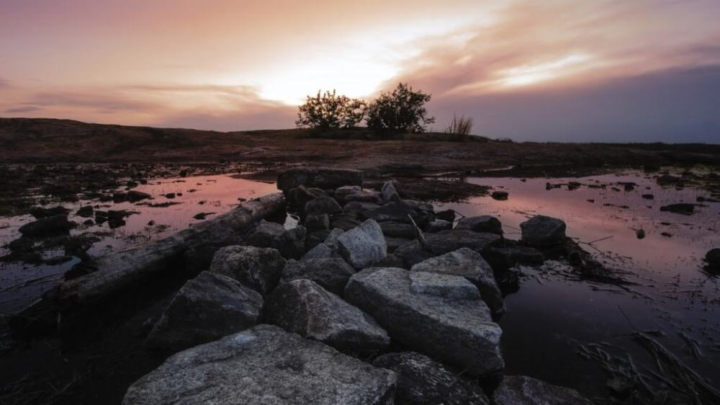 Sunrise over a pond and rocky outcroppings near Mt. Monadnock, NH