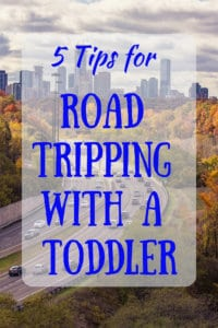 A arial view of a city with traffic. Caption: 5 Tips for Road Tripping with a Toddler