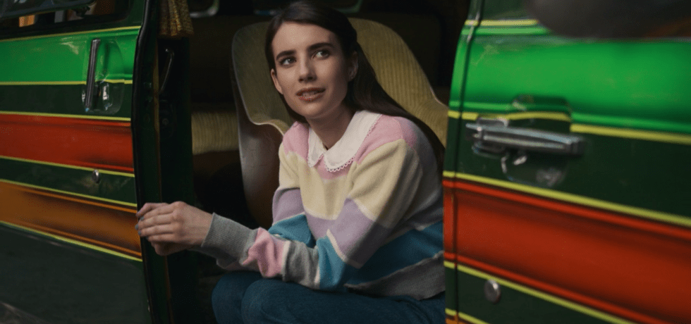 Emma Roberts' character Brooke sitting in a van.