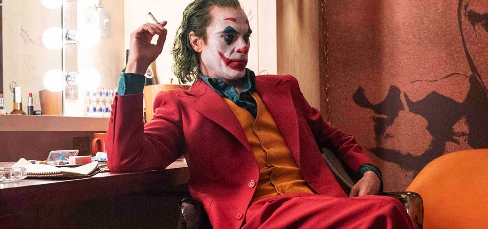 Joker smokes in dressing room.