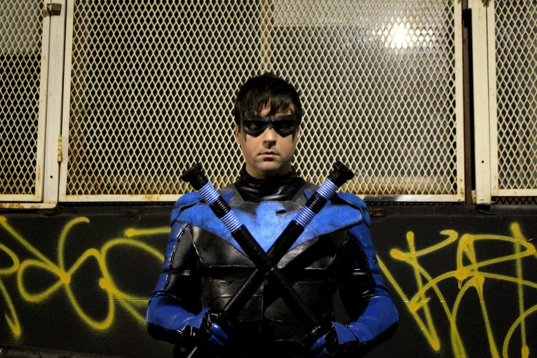Nightwing in a fighting stance.