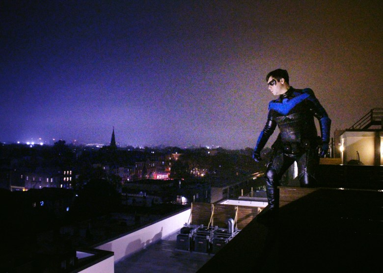 Nightwing is overseeing the streets high above Gotham.