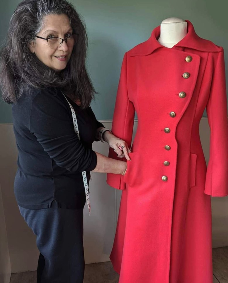 Annie Diaz putting the finishing touches on a garment.