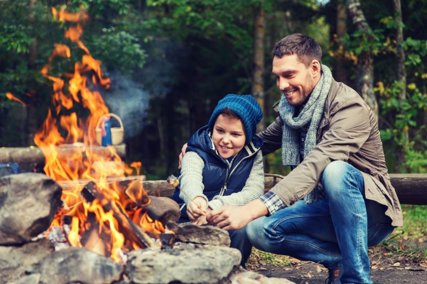 Camping Tourism Hike Family And People Concept Happy Father Son Roasting Marshmallow Over Campfire