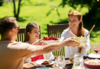 Leisure Holidays And People Concept Happy Family Having Festive Dinner Or Summer Garden Party Happy Family Having Dinner Or Summer Garden Party
