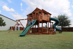 fort ticonderoga, ticonderoga, tri-level, twister slide, cabins, rock wall, wooden swing set, swing set, swings, slide, swing set for kids, kids, children, play, playground, playset, sets, accessories, backyard swing set