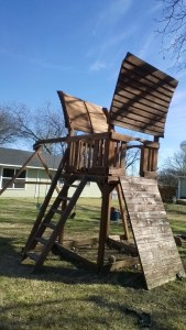playset, swing set, rock wall, stain service