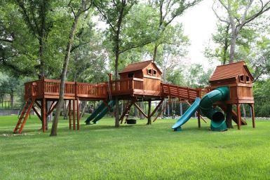 Ticonderoga bridged to Fun Shack and Tree Platform with monkey bars, Adventure Ramp, swings, playset, swing set, backyard swing set, backyard playset, twister slide, rocket slide, tire swing