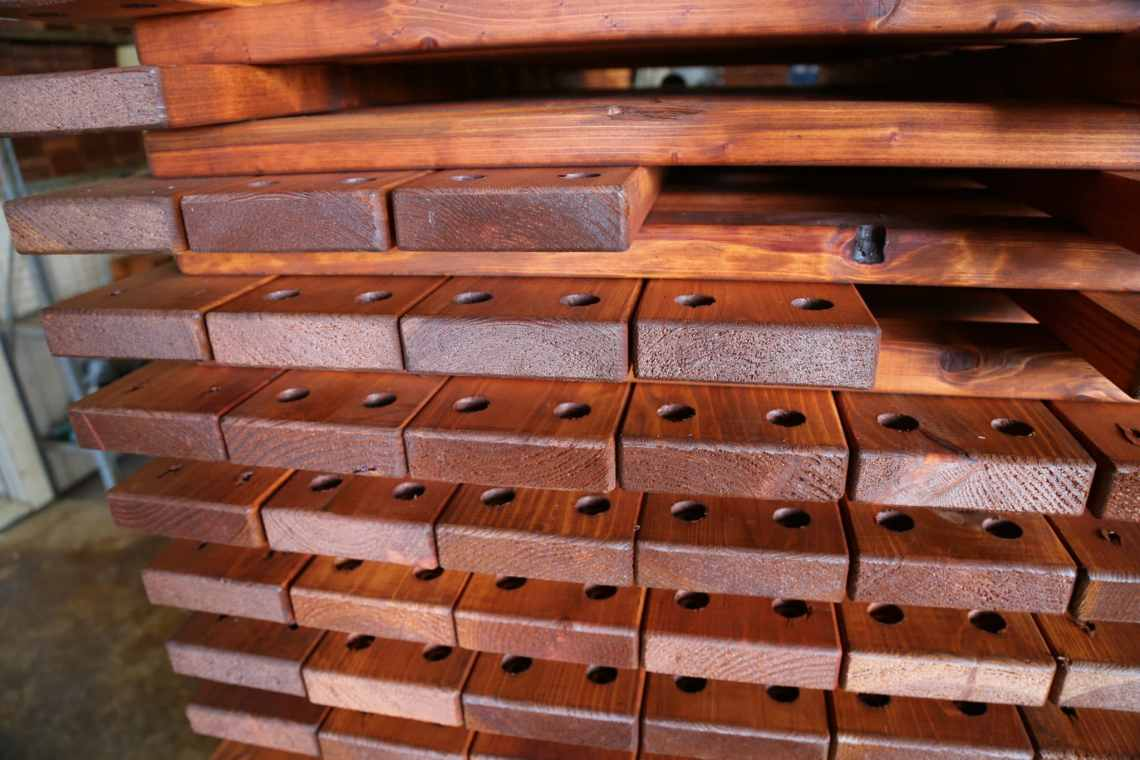 Redwood boards for Backyard Fun Factory's redwood playsets shown with pre-drilled holes.