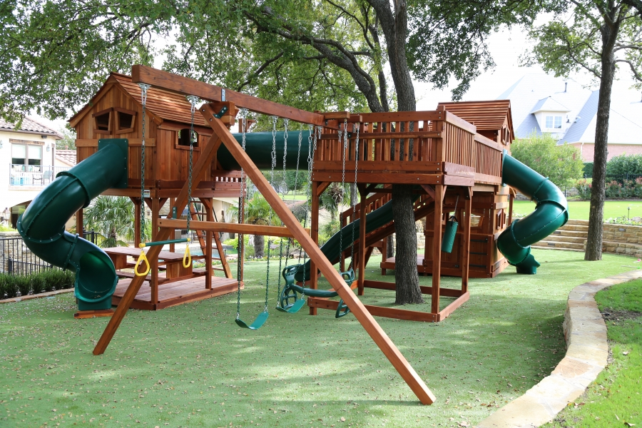 bridges, cabins, crawl tube, crawl tubes, fort, glider, lemonade stand, rock walls, slide, slides, swing set, swings, tree deck