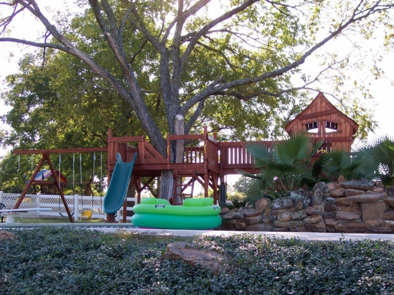 binoculars, bridge, climber, family, Fort Davis Jones, fun deck, outdoor, pool, punching bag, redwood, Rocket Slide, slide, steering wheel, swimming pool, swing, swing set, swings, tire swing, toddler swing, trapeze bar, tree, water cannon, outdoor playset