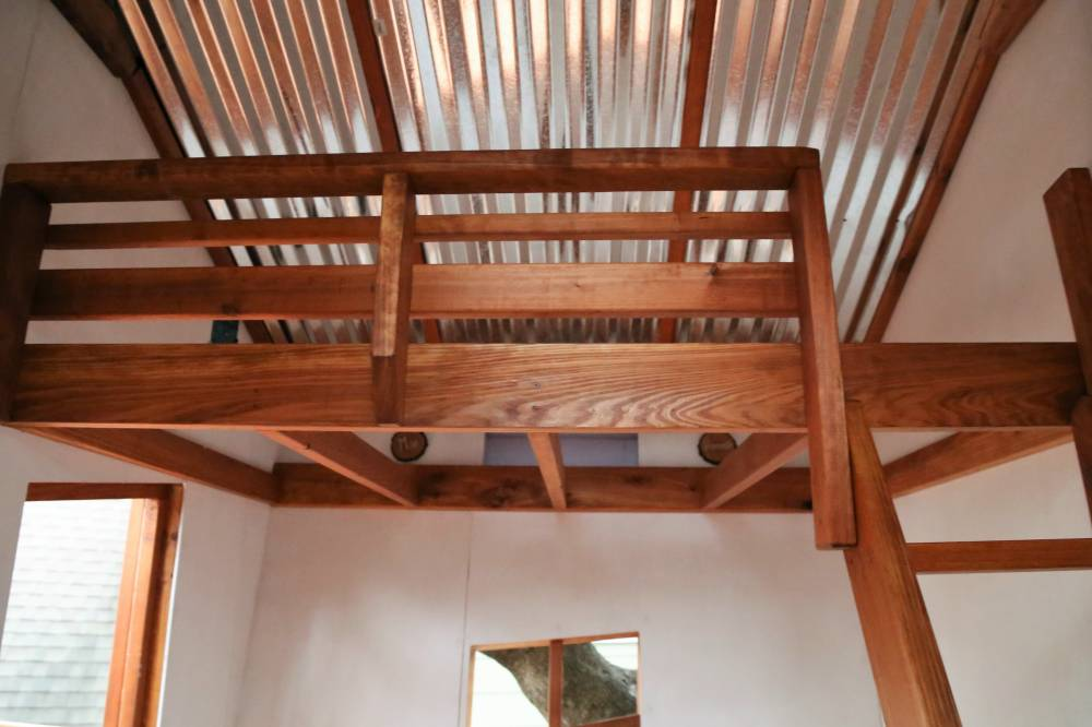 loft, interior of whimsical tree house, metal sheeting interior of roof,