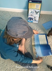 My Owlet reading a book ahead of the curriculum.