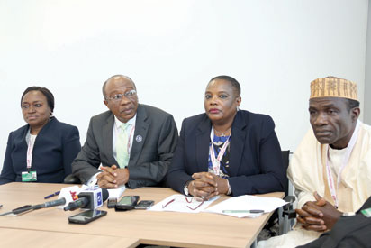 BRIEFING – Head of Nigerian Delegation and Governor, Central Bank of Nigeria, (CBN), Mr Godwin Emefiele, (2nd left), Deputy Governor, Mrs Sarah Alade (first left), Permanent Secretary, Ministry of Finance, Mrs. Anastasia Daniel-Nwaobia, and a director in the Ministry of Finance, Alhaji Haruna Mohammed, during a press briefing with Nigerian journalists who attended the 2015 Annual Meetings of the World Bank Group and International Monetary Fund in Lima, Peru.