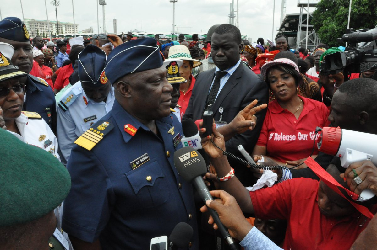 "Nigeria's chief of defense staff Air Marshal Alex S. Badeh, centre, speaks during a demonstration calling on the government to rescue the kidnapped girls of the government secondary school in Chibok, in Abuja, Nigeria, Monday, May 26, 2014. Scores of protesters chanting ""Bring Back Our Girls"" marched in the Nigerian capital Monday to protest the abductions of more than 300 schoolgirls by Boko Haram, the government's failure to rescue them and the killings of scores of teachers by Islamic extremists in recent years. (AP Photo/Gbenga Olamikan)"