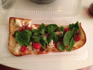 Alor Flatbread with goat cheese spinach red onion bacon and charred tomato
