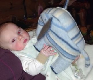 My nephew and his upcycled sweater elephant.