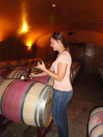 Laura used something like a glass turkey baster to draw a few ounces of wine out of the barrels to sample.