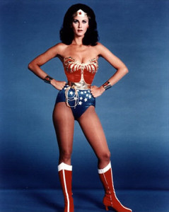 Lynda Carter as Wonder Woman standing with her hands on her hips, looking challengingly into the camera.