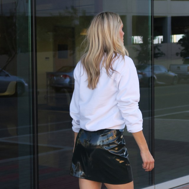 mini skirt and sweatshirt