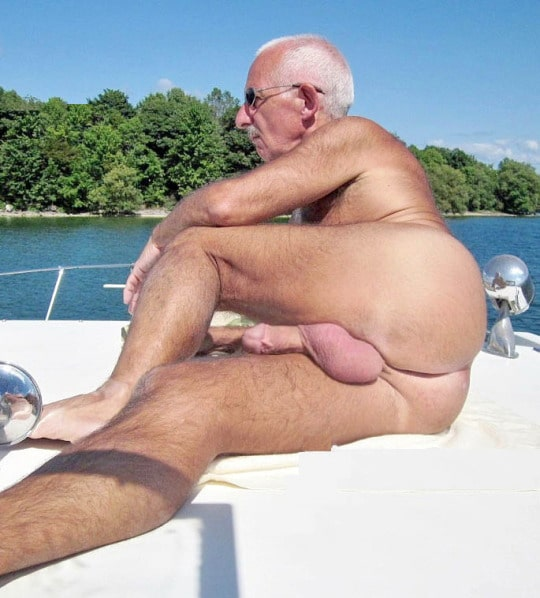 Naked and hard senior grand father showing off his balls outside