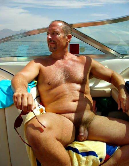 Dad tanning his big balls outside