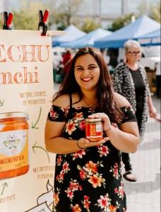 girl holding kimchi jar