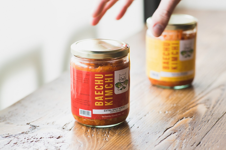 Reaching to grab a jar of kimchi