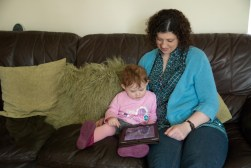 Showing Auntie Mary how to use an iPad