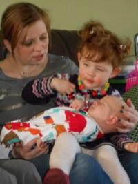 Cuddling Ezra on Auntie Liz's lap