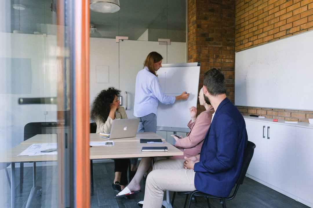 group of coworkers brainstorming in modern workspace