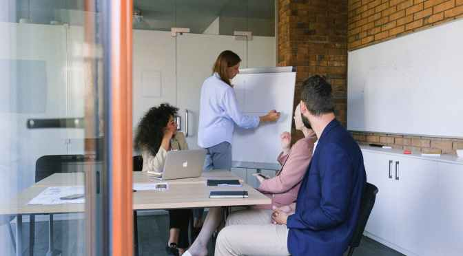group of coworkers brainstorming in modern workspace