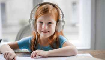 photo of girl wearing white headset