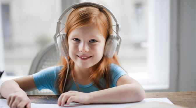 photo of girl wearing white headset