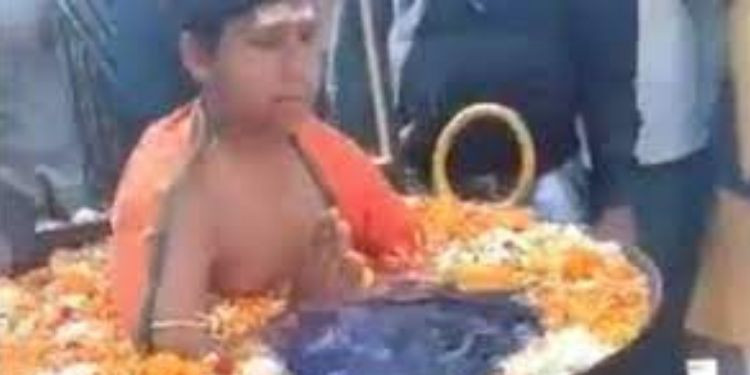 Social Media | viral video shows a boy sitting in boiling water netizens call it fake.