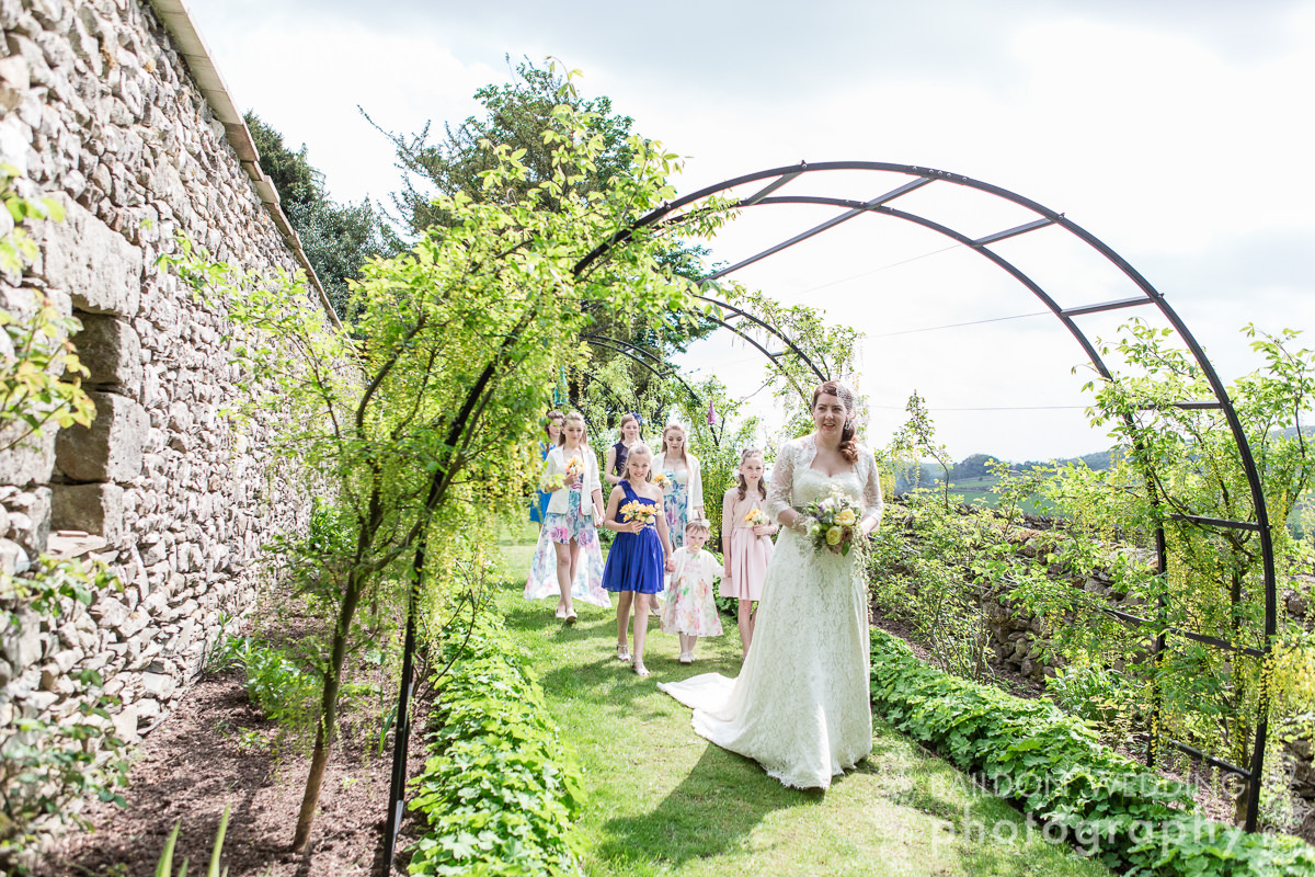 Bride walks through garden