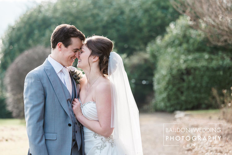 Backlit Bride and Groom portrait at Wood Hall wedding Leeds