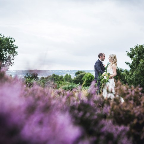 Bride and groom amongst the heather in the yorkshire countryside