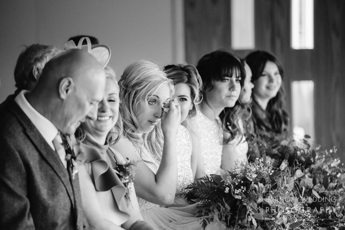 Emotional wedding bridesmaid cries