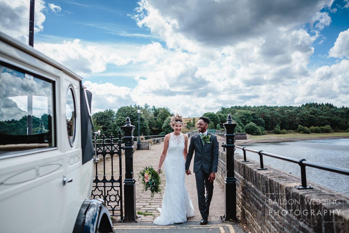 Walking to wedding car over the bridge Yorkshire