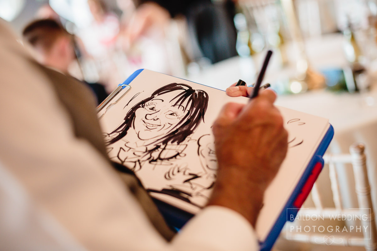 caricaturist at Yorkshire wedding drawing guests