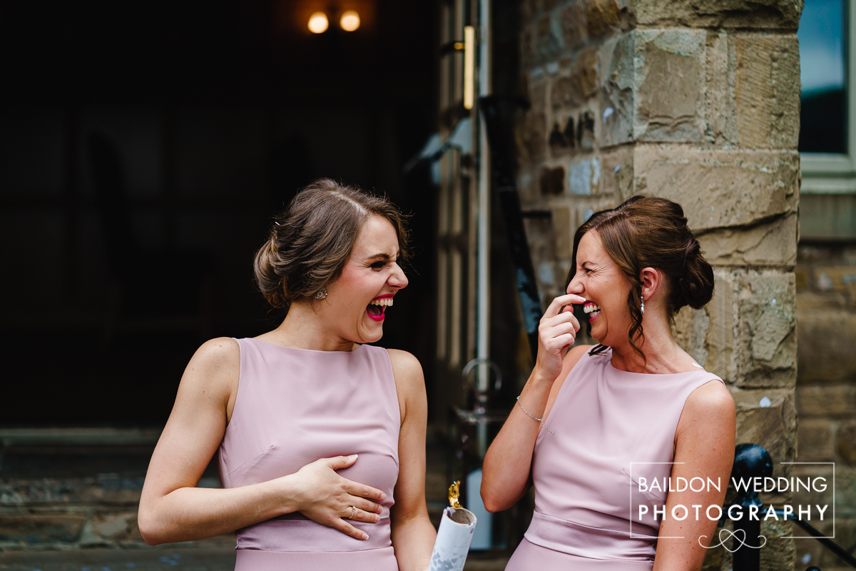 Photograph of bridesmaids laughing