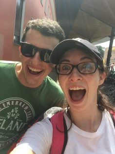 Man and woman excited at train station