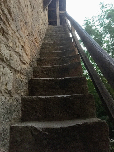 stairs leading up to medieval city wall