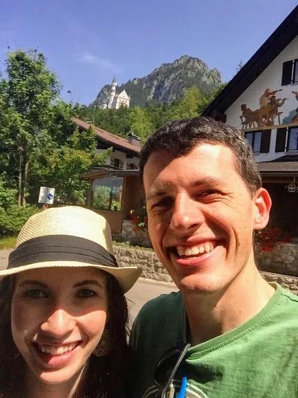 man and woman selfie in front of Neushwanstein Castle