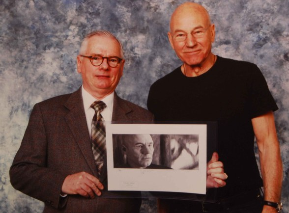 Robert presents a drawing to Patrick Stewart (Jean-Luc Picard, Star Trek TNG).