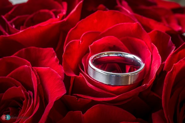 Wedding ring on rose bouquet