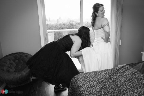 Bride and bridesmaid getting ready, bridesmaid's hand up dress