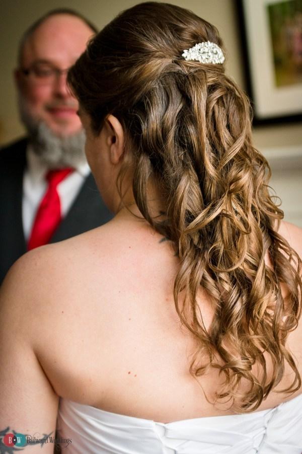 Groom looking at bride.
