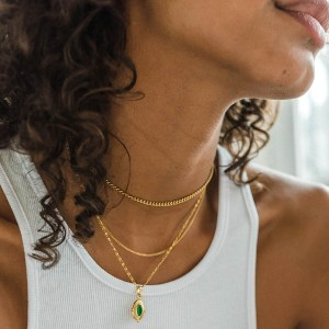 Sienna emerald green gold plated necklace in combination with the Elia chain choker